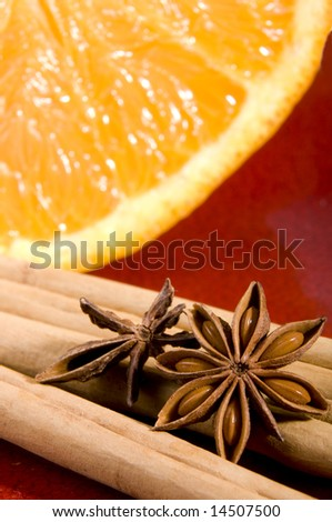 Cinnamon, anise and orange close up composition - stock photo