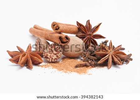 Cinnamon, anise, nutmeg, and cloves isolated on white background - stock photo