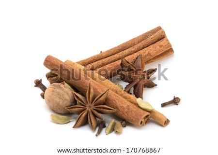 Cinnamon, anise, nutmeg, cloves and cardamom isolated - stock photo