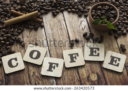 cinnamon, coffee beans and letters - stock photo