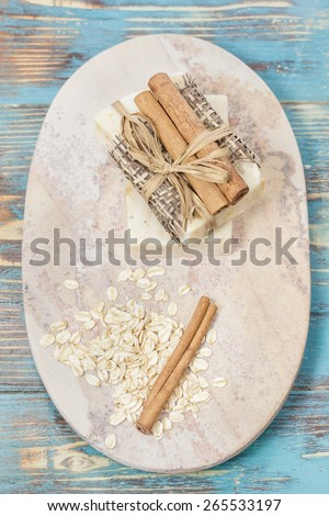 Cinnamon Oatmeal Soap. Aromatic spa. Handmade Cinnamon Oatmeal Soap  on granite stone background.  Macro, selective focus - stock photo
