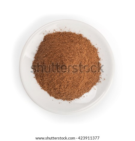Cinnamon powder pile on white background - top view - stock photo