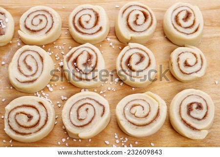 Cinnamon rolls before baking - stock photo