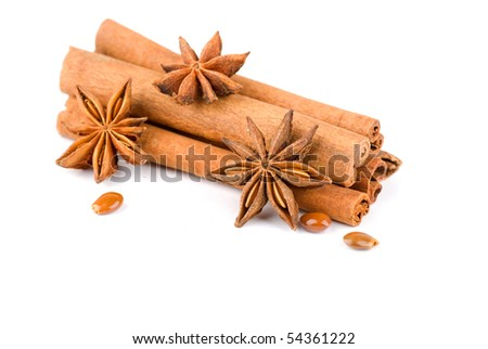 Cinnamon sticks and anise stars  isolated on white background - stock photo