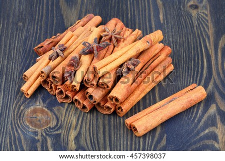 Cinnamon sticks and star anise spice on wooden table - stock photo