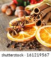 cinnamon sticks, cloves, anise stars and slices of dried citrus  - stock photo