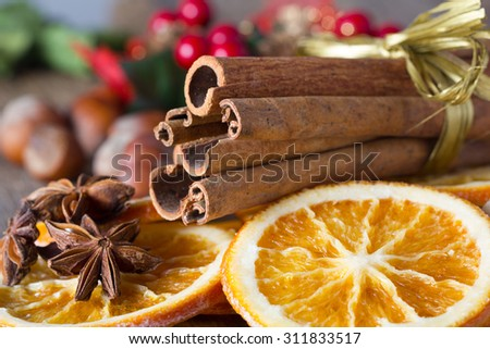cinnamon sticks, cloves, anise stars, nuts and slices of dried citrus - stock photo