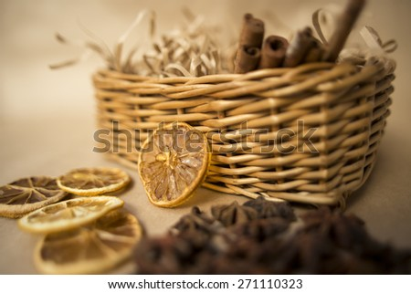 Cinnamon sticks in bucket on wooden background - stock photo