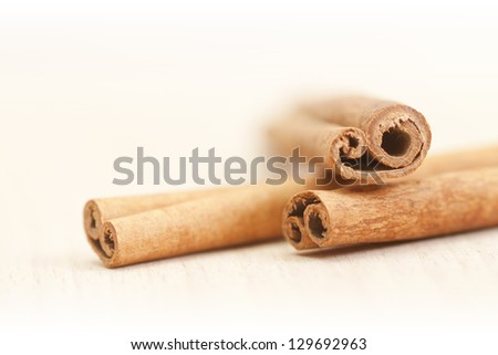 Cinnamon sticks isolated on white background  (Shallow DOF) - stock photo
