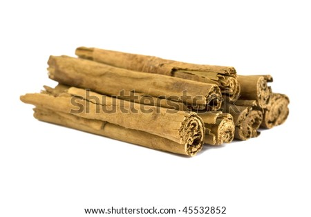 Cinnamon sticks isolated over a white background. - stock photo