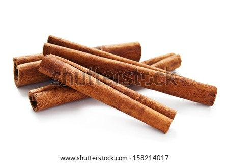 Cinnamon sticks on the white background - stock photo