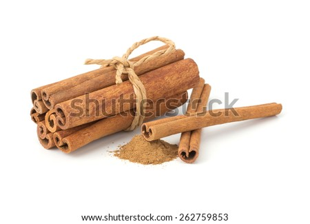 Cinnamon sticks with cinnamon powder isolated on white background - stock photo