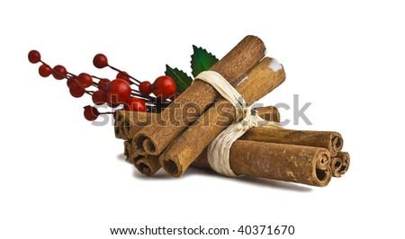 Cinnamon sticks with mistletoe - stock photo