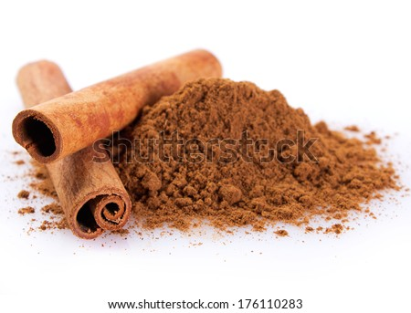 cinnamon sticks with powder isolated on white background - stock photo