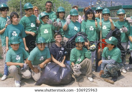 """CIRCA 1990 - """"Clean & Green"""" environmental volunteers at a river cleanup, part of the Los Angeles Conservation Corps"""" - stock photo"""