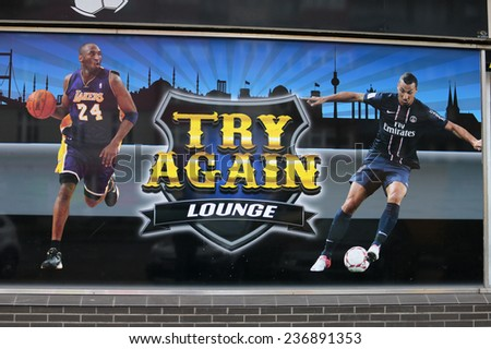 "CIRCA OCTOBER 2014 - BERLIN: the logo of the brand ""Try Again Lounge"" with the portraits of the sport stars Kobe Bryant and Zlatan Ibrahimovic, Berlin. - stock photo"