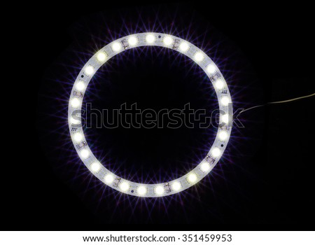 circle led light bulb over black background - stock photo