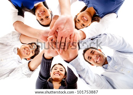 Circle of friends with hands together in the middle - teamwork concepts - stock photo