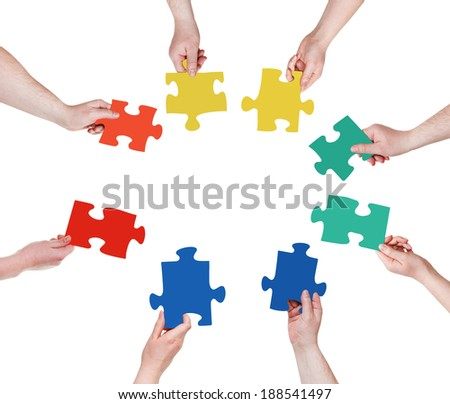 circle of people hands with puzzle pieces isolated on white background - stock photo
