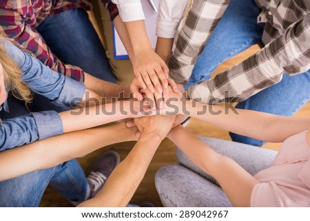 Circle of trust. Group of people sitting in circle and supporting each other. - stock photo