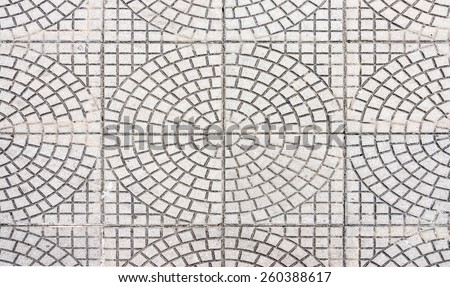 Circle pattern tile on the pavement in urban park. - stock photo