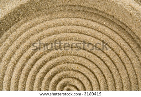 Circle Patterns in Sand. - stock photo