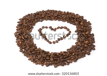 Circle roasted coffee beans with a heart in the middle on white isolated background. - stock photo