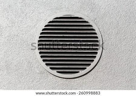 Circle vent window on metallic concrete wall - stock photo