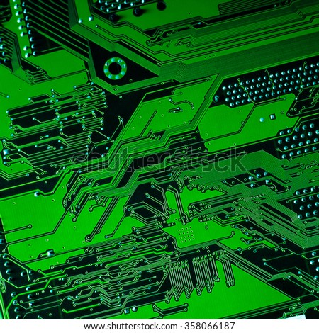 Circuit board. Electronic computer hardware technology. Motherboard digital chip. Tech science background. Integrated communication processor. Information engineering component. Blue, green color. - stock photo