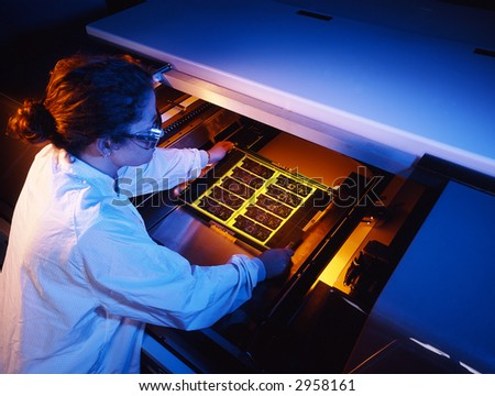 Circuit board technician - stock photo
