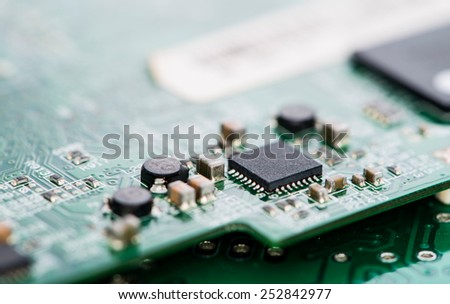 Circuit Board with a lot of different components (close-up shot) - stock photo