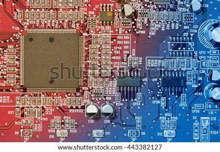 Circuit board with electronic components. Computer and networking communication technology concept. Toned image. - stock photo