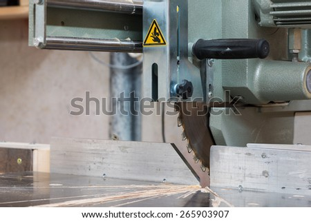 circular buzz saw on table with rail and grip of carpenter  - stock photo