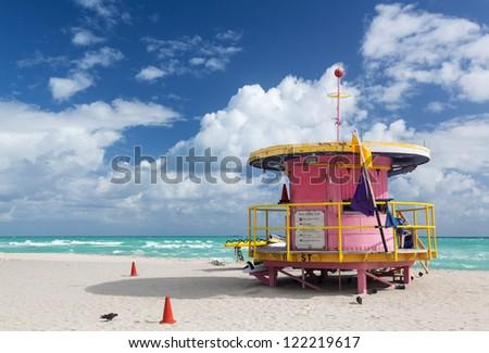 Circular round pink lifeguard station on Miami beach Florida - stock photo