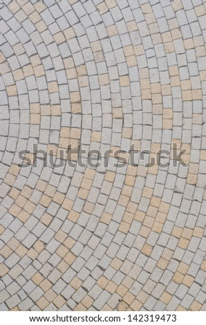 Circular street path yellow and grey pavement - stock photo
