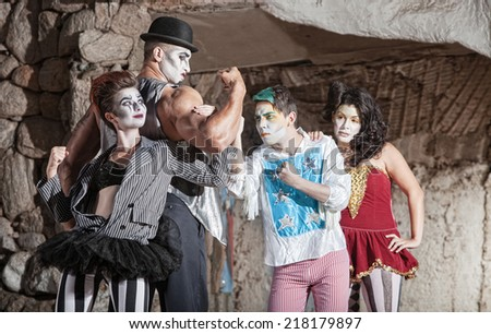 Circus comedy drama ensemble performing at outdoor theatre - stock photo