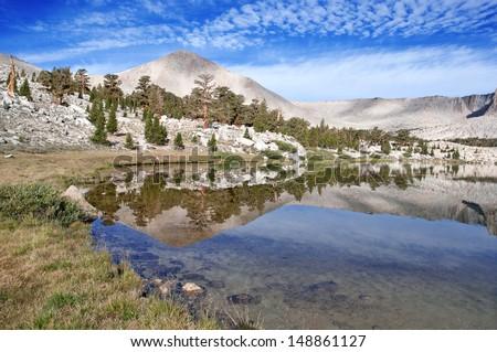 Cirque Peak Reflection in Lake, Sierra Nevada Mountains, California, USA - stock photo