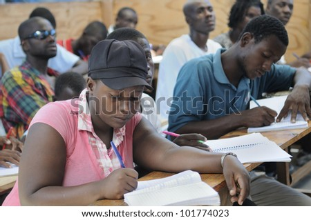 CITE SOLEIL- AUGUST 25:  Students doing their classwork in a local community school in Cite Soleil- one of the poorest area in the Western Hemisphere on August 25 2010 in Cite Soleil, Haiti. - stock photo