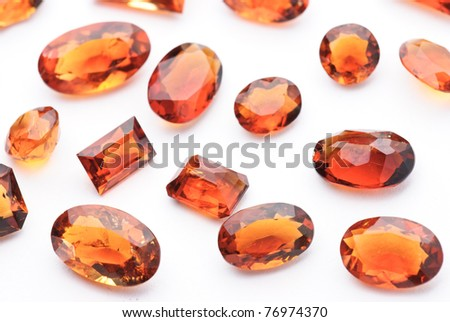 citrin jewel, precious gemstone isolated against a white background - stock photo