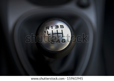 Citroen gear-lever on black background - stock photo