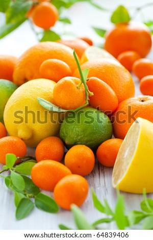 Citrus fresh fruit on the white wooden table - stock photo