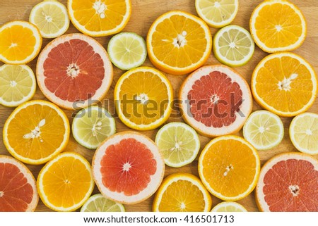 Citrus fruit background with sliced oranges lemons lime tangerines and grapefruit as a symbol of healthy eating and immune system boost with natural vitamins. - stock photo