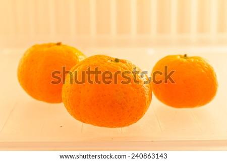 Citrus fruit in the fridge. - stock photo