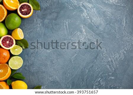 Citrus fruits background with oranges  and lemons - stock photo