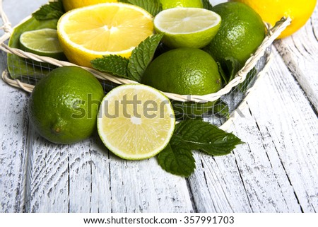 Citrus fruits in basket - stock photo