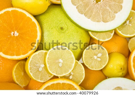 citrus fruits mix surface close up top view  background - stock photo