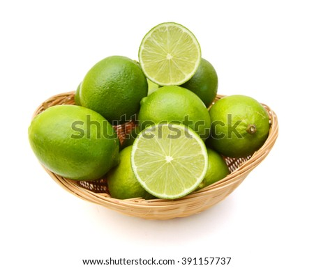 Citrus lime fruit isolated in basket on white background cutout  - stock photo