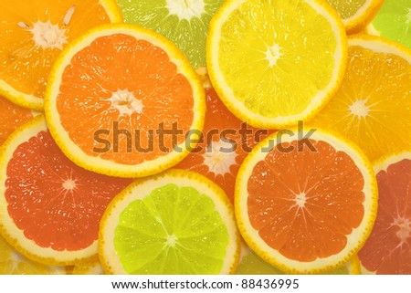 Citrus slice series in different colors, background - stock photo