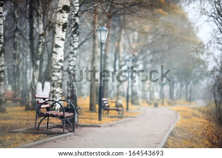 city ??alley autumn bench loneliness - stock photo