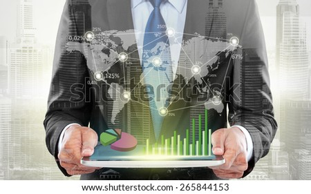 city and businessman using hightech digital tablet. conceptual business technology - stock photo